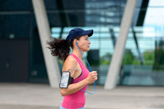 Fit young woman jogging through town stock images