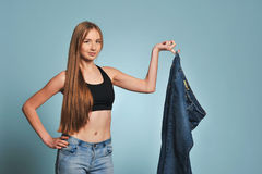 Fit young woman in loose jeans Stock Image