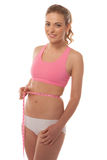 Fit young woman measuring her waist Stock Images