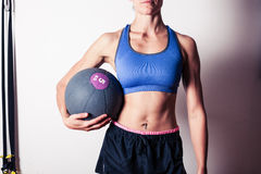Fit young woman with medicine ball Royalty Free Stock Images