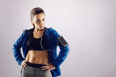 Fit young woman posing confidently in sportswear Royalty Free Stock Image