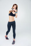 Fit young woman punching towards camera Stock Photography