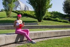 Fit young woman resting after training in park Royalty Free Stock Photo