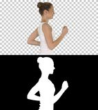 Fit young woman running, Alpha Channel royalty free stock images