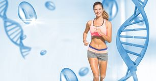 Fit young woman running by DNA structure. Digital composite of Fit young woman running by DNA structure royalty free stock photography