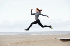 Fit young woman running and jumping Royalty Free Stock Photos