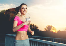 Fit young woman running  outdoors Royalty Free Stock Photo