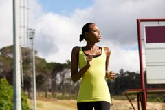 Fit young woman running outside Stock Images