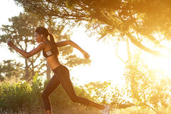 Fit young woman running outside Royalty Free Stock Photo