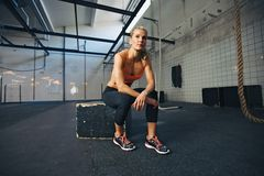 Fit young woman sitting at crossfit gym Royalty Free Stock Photo
