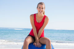 Fit young woman sitting on exercise ball looking at camera Royalty Free Stock Photo