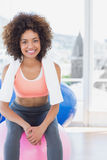 Fit young woman sitting on fitness ball at gym Royalty Free Stock Photos