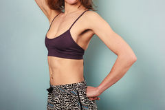 Fit young woman in sports bra and shorts Stock Photography