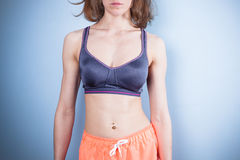 Fit young woman in sports bra and shorts Stock Photo