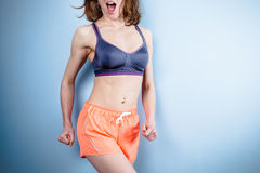 Fit young woman in sports bra and shorts Royalty Free Stock Photo
