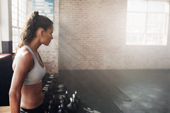 Fit young woman in sportswear at the gym Stock Photography