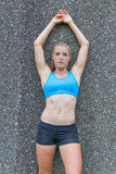 Fit young woman spread against the wall Stock Photos