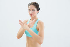 Fit young woman standing in defending posture Stock Images