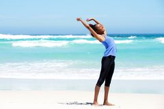 Fit young woman stretching at beach Stock Image