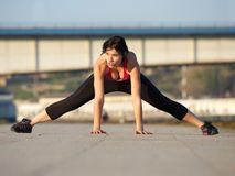 Fit young woman stretching muscles outdoors Royalty Free Stock Photo