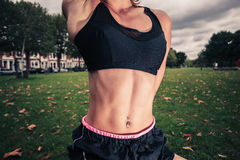 Fit young woman stretching in the park Royalty Free Stock Images