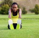 Fit young woman stretching toe touch exercise  in the park Stock Image
