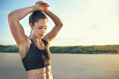 Fit young woman with toned abdominal muscles Royalty Free Stock Images