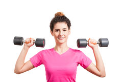 Fit young woman training her deltoids with barbells Royalty Free Stock Images