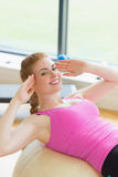 Fit young woman working out with exercise ball Royalty Free Stock Images