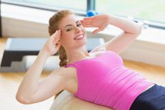 Fit young woman working out with exercise ball Stock Photography