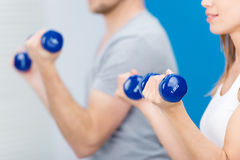 Fit young woman working out at a gym stock images