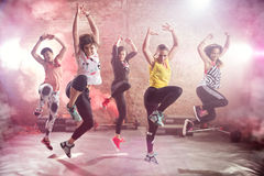 Fit young women dancing  and exercising. Group of fit young women dancing  and exercising Stock Image