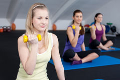 Fit young women lifting weights Stock Photos