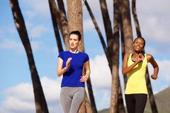 Fit young women running outdoors in nature Royalty Free Stock Images