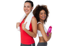 Fit young women standing with waterbottle and towel Stock Image