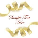 Fita brilhante do cetim do ouro no fundo branco Imagem de Stock Royalty Free