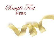 Fita brilhante do cetim do ouro no fundo branco Fotos de Stock Royalty Free