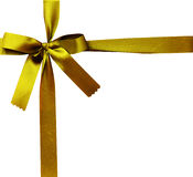 Fita brilhante do cetim do ouro no fundo branco Imagens de Stock Royalty Free