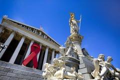 Fita da conscientização do SIDA no parlamento austríaco Fotografia de Stock
