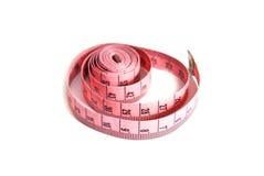 Fita de medição cor-de-rosa isolada no fundo branco Fotografia de Stock
