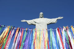 Fita do Bonfim Brazilian Wish Ribbons Corcovado Rio. Fita do Bonfim Brazilian wish ribbons strung in blue sky at Corcovado Christ the Redeemer statue Rio de Royalty Free Stock Photography