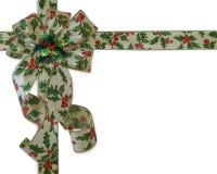 Fita e curva do azevinho da beira do Natal Foto de Stock