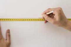 Fita e lápis de medição Fotos de Stock