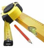 Fita, nível e lápis de medição Fotos de Stock