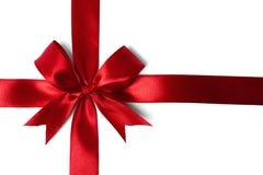 Fita vermelha brilhante do cetim no fundo branco Fotografia de Stock Royalty Free
