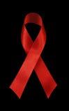 Fita vermelha - consciência do AIDS Imagem de Stock Royalty Free