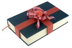 Fita vermelha livro preto amarrado Fotografia de Stock Royalty Free