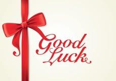 Fitas e cartão vermelhos, curvas, boa sorte Imagem de Stock Royalty Free