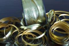 Fitas metálicas do ouro Fotografia de Stock Royalty Free