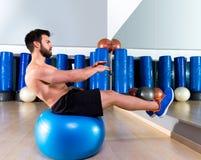 Fitball abdominal balance crunch Swiss ball man Stock Image